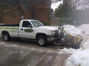 A snow pusher truck removing snow