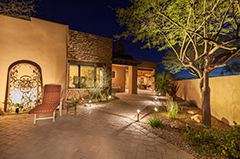 Landscape Lighting In The Backyard of a House