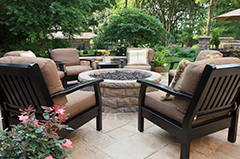Patio Fire Pit and Sofas in a Backyard